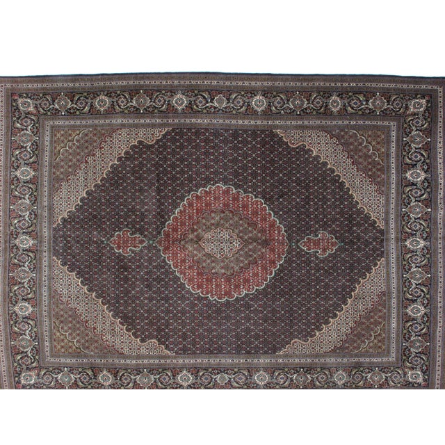 Wool pile hand made Black Persian Mahi Tabriz in mint condition.