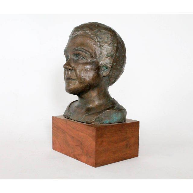 Plaster bust mounted on wood, signed Colette S. Minimal signs of wear.