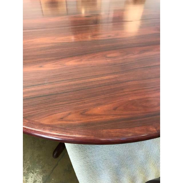 """Kai Kristiansen Expandable Rosewood Dining Table with for matching chairs. 48"""" without leaves Set includes two 19.75"""" leaves"""