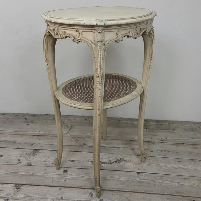 19th Century French Louis XVI Painted Oval End Table represents the essence of the classical form, with subtly...