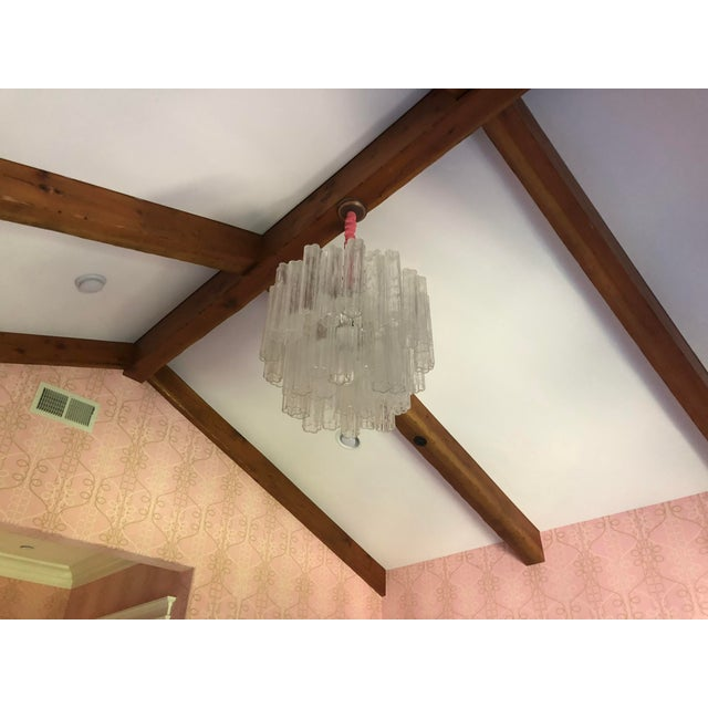 Vintage clear glass chandelier with two tiers of hollow glass rods was selected from a vintage shop by Jay Jeffers 11...