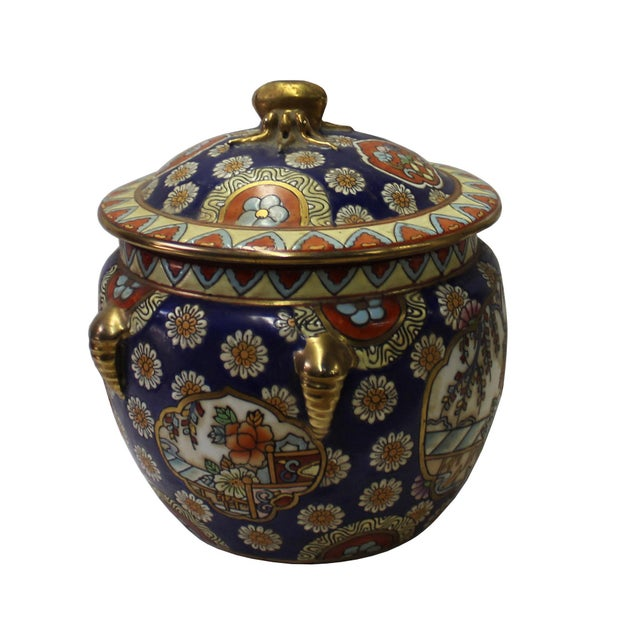 This is a Chinese decorative porcelain round box with flower pattern painted on the surface. It is a Republic of China...