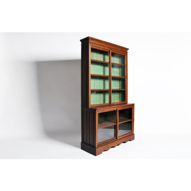 This handsome British Colonial bookcase is from Mandalay, Burma and is made from teak wood, circa mid-1900s. This cabinet...