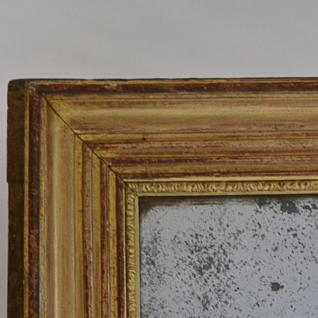 This might have been an unassuming hallway mirror in an upscale home when it was new, back around 1860. Today, though,...