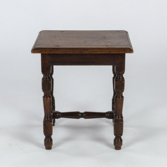 English oak square stool with turned legs and H-stretcher, circa 1890. height: 15 in. 38 cm., width: 14 in. 35.5 cm.,...