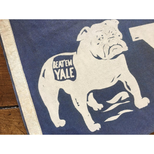 Fabulous old Yale football pennant - football graphic at one end, Handsome Dan at the other. Minor fading, very good...
