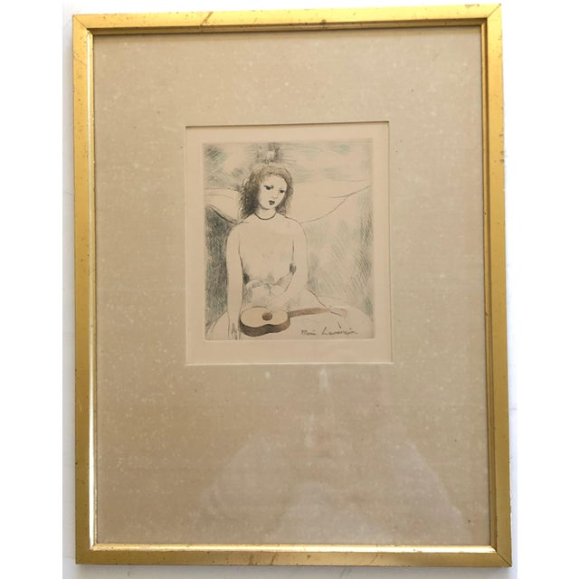 """Marie Laurencin's circa 1946 hand colored etching """"Jeune Femme aux Guitare"""", printed as part of the book """"Alternance"""",..."""
