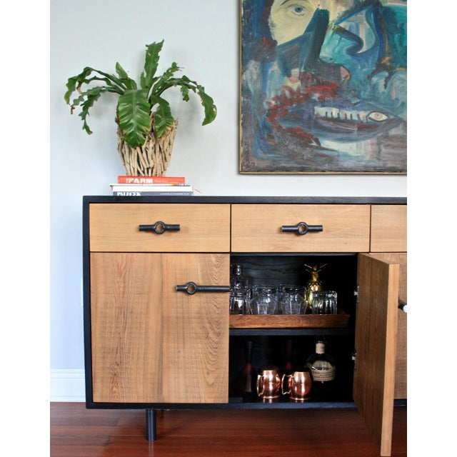 Franklin credenza is modern rustic sideboard crafted from reclaimed cypress and ash wood from the Mississippi Delta. The...