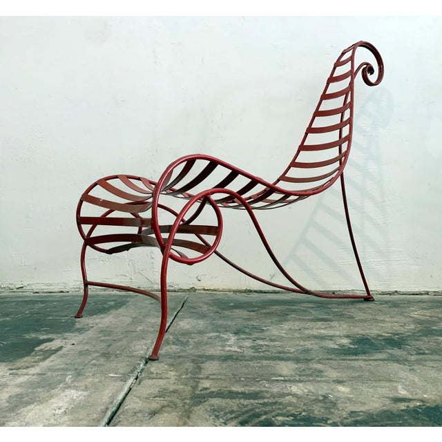 Available right now we have this stunning candy-cane red spine chair attributed to Andre Dubreuil. This post modern...