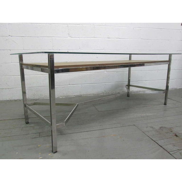 Large unique desk with a flat chrome-plated steel base.