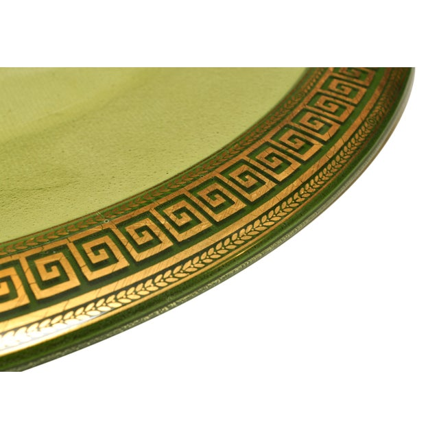 A transparent, vintage green plate with a gold greek key border. A great decorative item for the home! *Note: Item cannot...