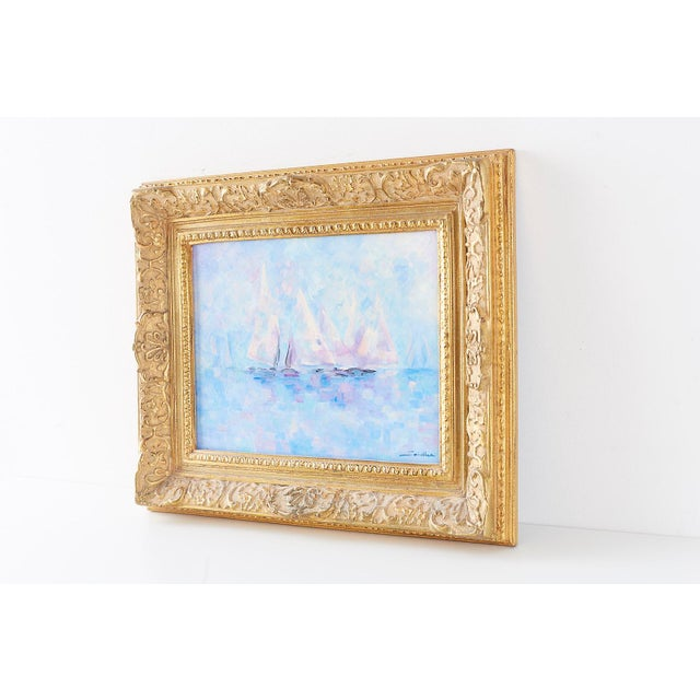 Delightful Mid-Century Modern painting of sailboats set in a thick giltwood frame. Oil on canvas in lovely pastel colors....