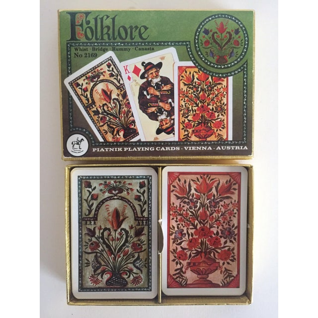 This vintage Mid Century Folklore lithograph playing cards double deck boxed set is a very special and unique set to add...