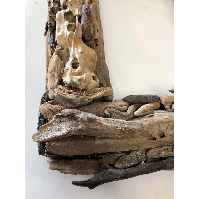 Handcrafted applied driftwood from Botany Bay in Edisto Island, South Carolina. Would make a wonderful mirror frame.