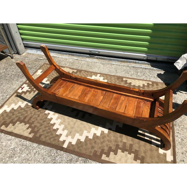 A very eye-catching piece, Exotic Antique Solid Wood Handcrafted Bench. Beautiful details in the wood. Excellent condition