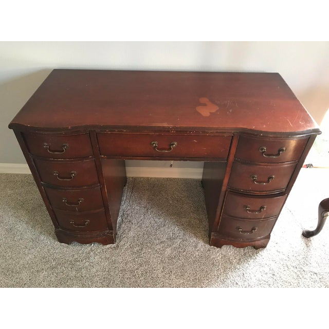 Vintage cherry desk that has been in my family for a while. It is perfect for refinishing and selling. Made in the 1960s.