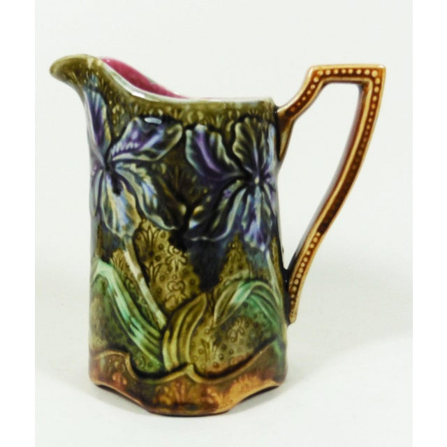 French Majolica iris pitcher signed Onnaing, circa 1900.