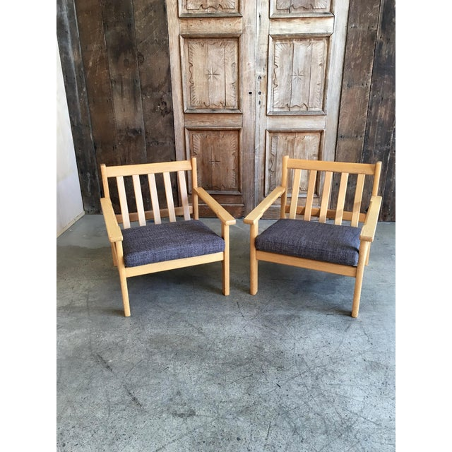 Great pair on Danish modern in white oak with gray fabric by Hans Wegner.