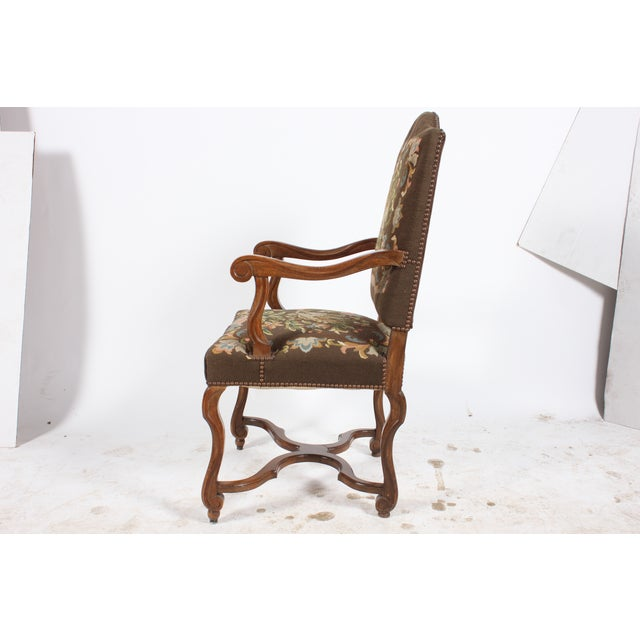 1920s Austrian Needlepoint fauteuil featuring lovely floral designs centered around a large bird, back of chair is covered...