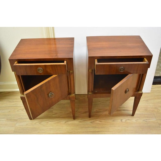 This pair of vintage Italian nightstands are likely midcentury and each feature one drawer and one cabinet, hinged on the...