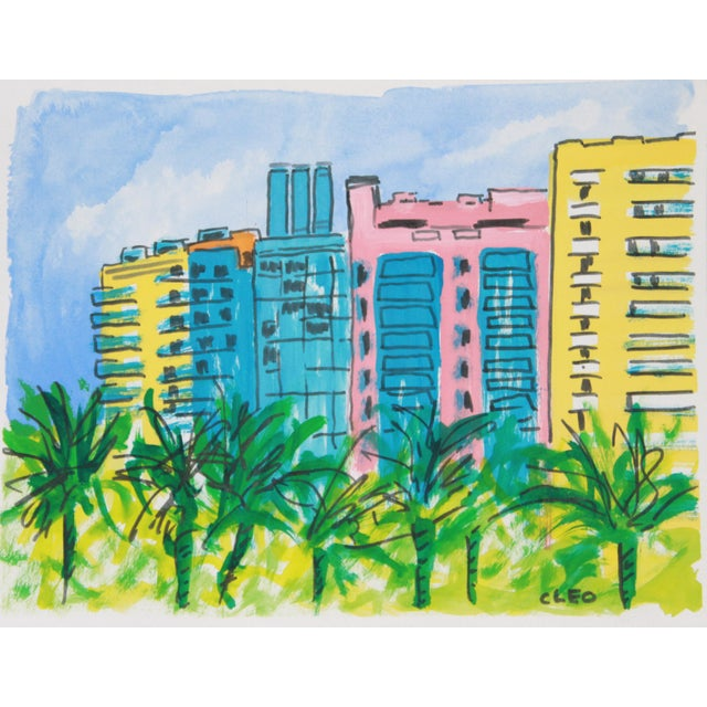 A section of Art Deco buildings is the focus of this street scene in Miami Beach, painted in pink, apricot, aqua, blue,...