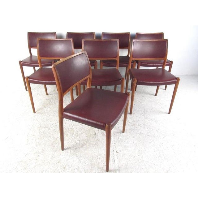 This beautiful vintage dining set features eight model 80 dining chairs by Niels Moller for JL Moller mobler paired with...