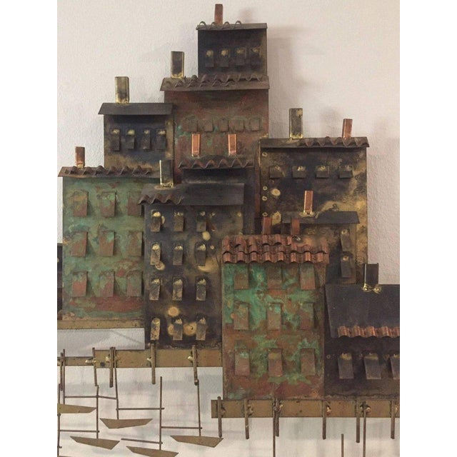 Signed Curtis Jere (Curtis Freiler and Jerry Fells) brass wall sculpture featuring a village, marina and sailboats...
