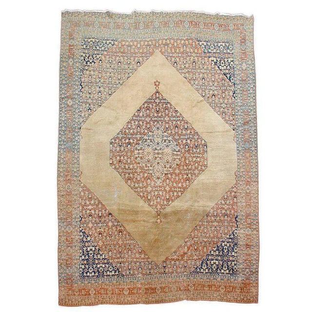 This elegant Tabriz carpet balances open spaces with areas of finely detailed and precise drawing composed in a soft...