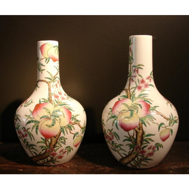 "A fine pair of Chinese porcelain ""peaches"" bottle vases (tianquiping) from the late Qing Dynasty or early Republic period...."