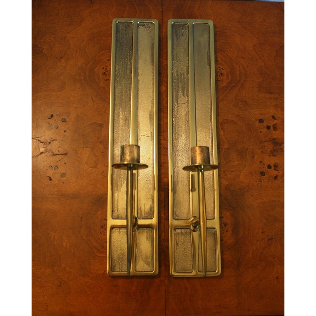 These lovely, Mid-Century Modernist brass candle sconces are in the style of Parzinger and Stilnovo. Condition: Very good...