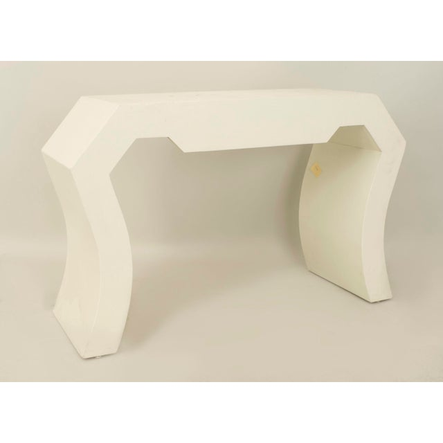 American midcentury white painted console table with a geometric shape with concave sides
