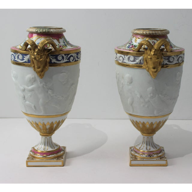 Impressive pair of hand-painted garniture urns, each marked in verso with what appears to be a French Sevres mark - the 2...
