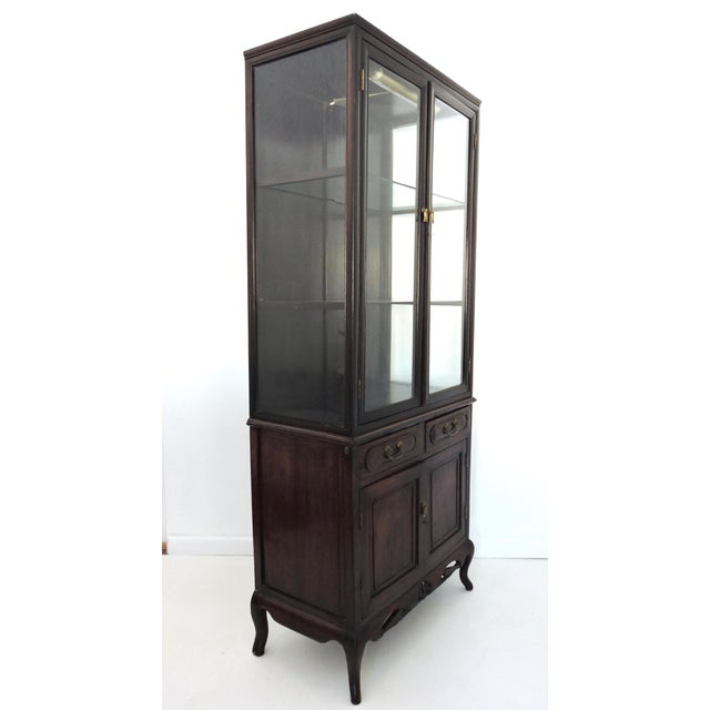 Classic antique Chinese style display/storage cabinet with two glass shelves, glass doors and glass sides, over 2 drawers,...