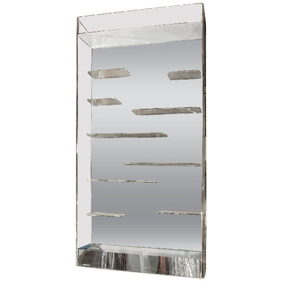 Fantastic Les Prismatiques free floating Lucite shelves and mirrored wall vitrine. Retains its original Etched Makers...