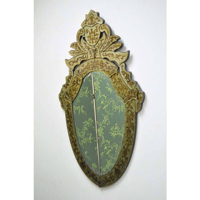 Item: Decorator Contemporary Venetian Style Gold Etched Shield Shaped Wall Mirror Details: Ornate shapely frame, beveled...