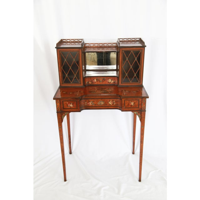 Antique Federal-style handcrafted hardwood desk with hand-painted motifs. Features two curio cabinets with diamond-cut...