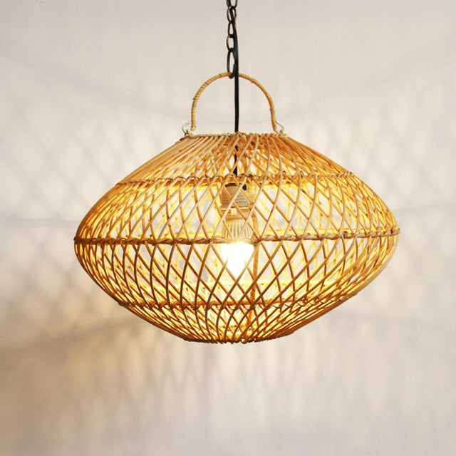 Wicker rattan basket form hanging light fixture. There are 11 lanterns available, please contact support@chairish.com in...