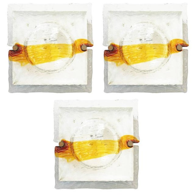 Vintage Italian wall lights or flush mounts with amber and clear Murano glass hand blown in to a quilt-like effect by...
