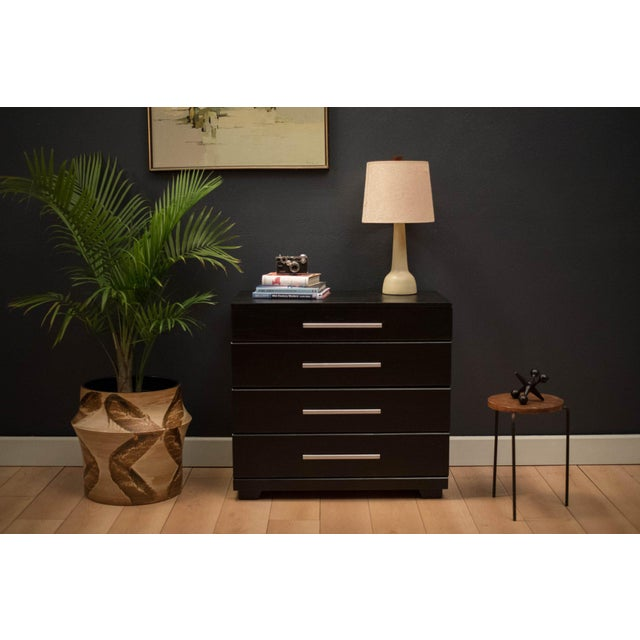 Mid-century dresser chest designed by Raymond Loewy for Mengel Furniture Co. in ebonized solid oak. This piece features...