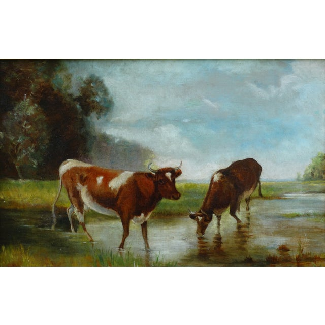 Late 19th-Century Continental School oil on canvas of cattle in a stream with a landscape. The cattle are painted with...