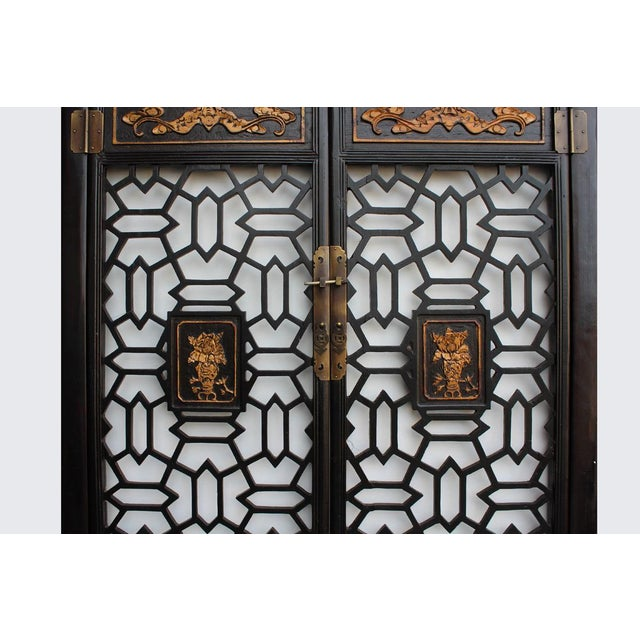 This is a vintage wooden wall decor panel screen with dark brown rim finish. It has precise relief carving motif with...