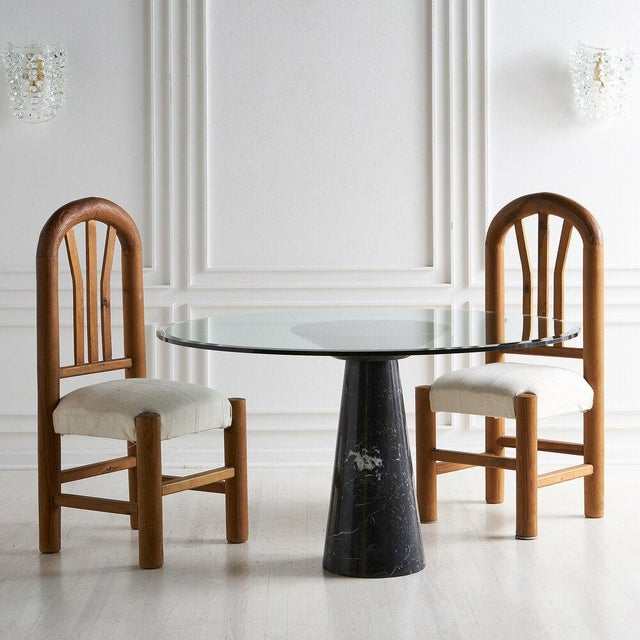 A stunning Nero Marquina marble base dining table by Italian Architect and industrial designer Angelo Mangiarotti....