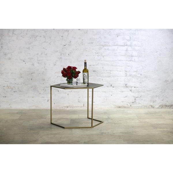 This table is a easy to use in any room. It's a substantial size yet light enough to move around to sit next to any seat...