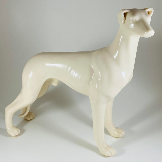 """2 beautiful white ceramic Greyhound Dog Statues figurines Mid Century Modern Authentic Vintage Both Measure 8"""" long x 7""""..."""