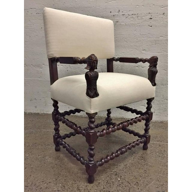 Barley twist framed chairs with carved faces to the front of arms. Nice patina. Wood in excellent condition. Upholstered...