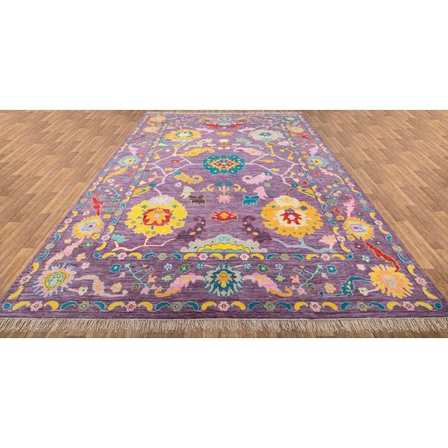 This is a contemporary Turkish Oushak rug in vivid colors for modern homes. The rug is made in robust handspun wool from...