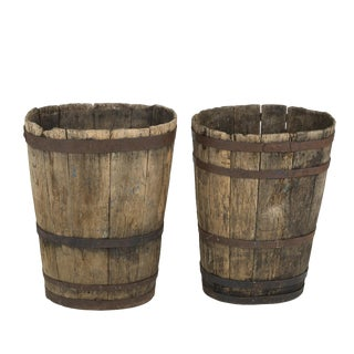 A Companion Pair of Weathered Metal-Strapped French Oak Barrels, circa 1870.