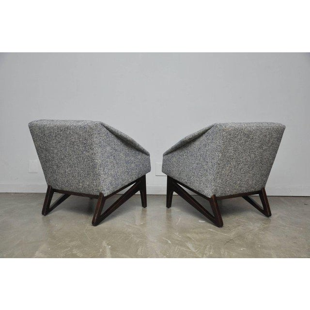 Italian lounge chairs with sculptural from walnut bases with diamond form arms. Fully restored and reupholstered in new...