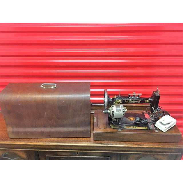 Greyhound Electric portable sewing machine with wood carrying case. Displays nicely -- never tried to plug it in so not...