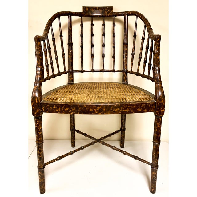 Pair of barrel back chairs by Baker Furniture. The finish is a faux tortoise. It has the label on the underside.